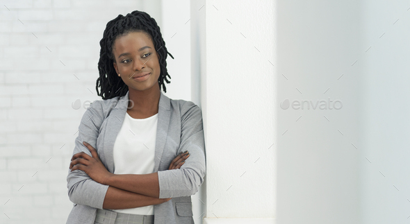 Afro Business Girl Standing Next To Window Indoor, Panorama - Stock Photo - Images