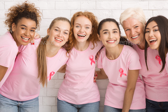 Women With Pink Breast Cancer Ribbons Laughing On White Background - Stock Photo - Images