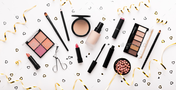 Review of modern decorative cosmetics with golden confetti - Stock Photo - Images
