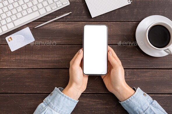 Female hands holding smartphone with blank screen for advertisement - Stock Photo - Images