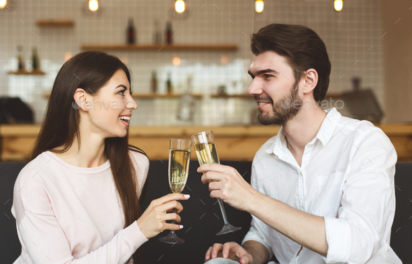 Happy young couple congratulating each other with anniversary - Stock Photo - Images