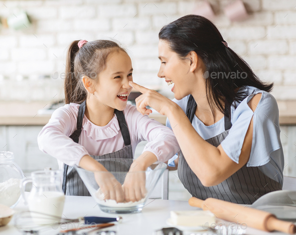 Cute Girl Kneading Dough For Pie, Having Fun With Mom - Stock Photo - Images
