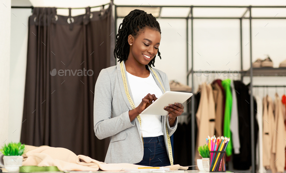 Afro Fashion Designer Using Tablet Browsing Internet In Dressmaking Studio Stock Photo By Prostock Studio