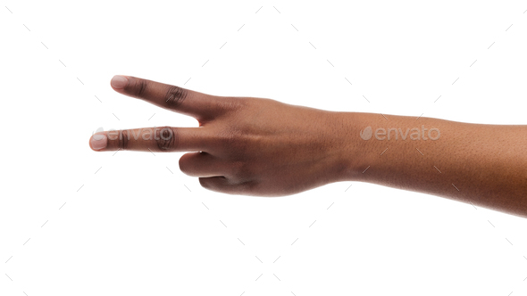 Woman's hand showing number two or peace sign with fingers - Stock Photo - Images