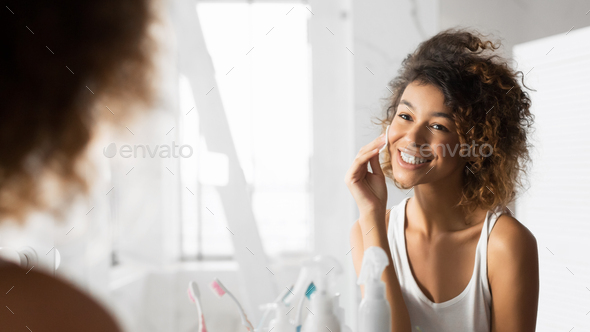 Afro Girl Cleaning Face Using Cotton Pads In Bathroom, Panorama - Stock Photo - Images