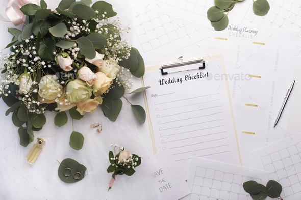 Empty checklist with planner and bouquet of roses - Stock Photo - Images