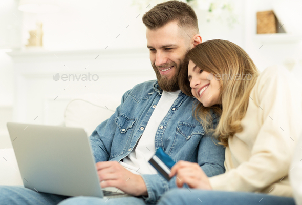Easy to buy. Young couple shopping online on laptop - Stock Photo - Images