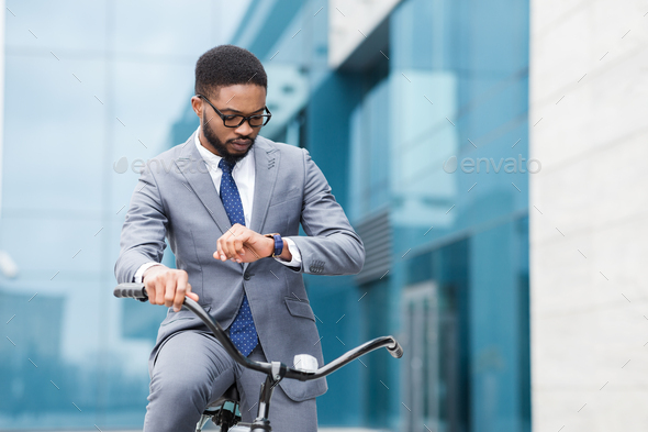 Way to work. Male manager checking time on his watch - Stock Photo - Images