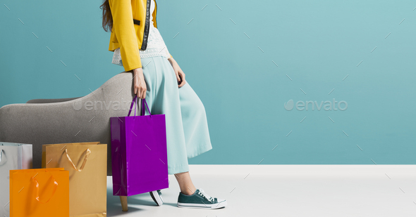 Stylish woman carrying a lot of shopping bags - Stock Photo - Images