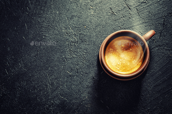 Cup of fresh made coffee served in cup - Stock Photo - Images