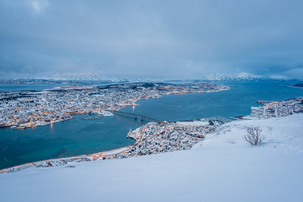 Aerial view to the city of Tromso in winter - Stock Photo - Images