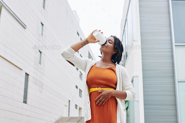 Woman drinking coffee - Stock Photo - Images