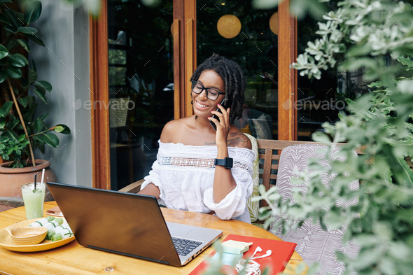 Businesswoman working at cafe - Stock Photo - Images