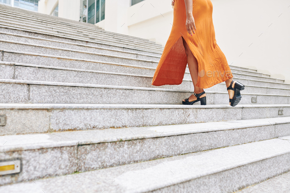 Woman moving up the stairs - Stock Photo - Images