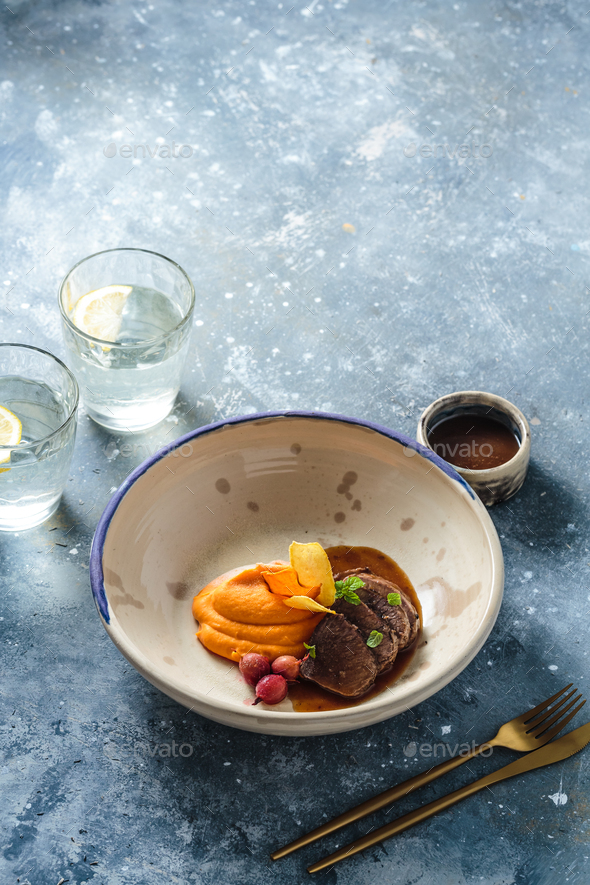 Slow braised lamb with sweet potato puree, restaurant dish, copy space - Stock Photo - Images
