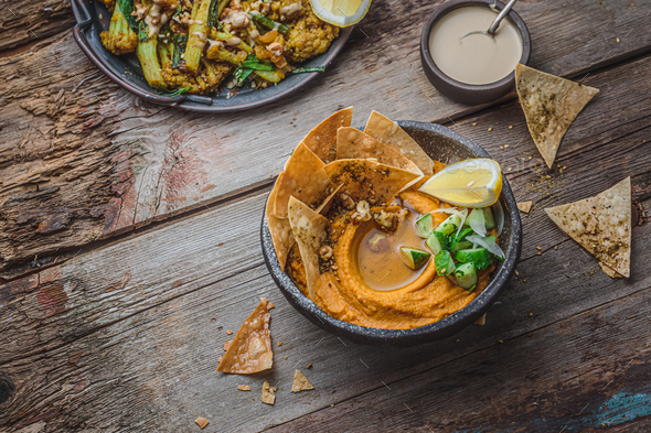Hummus with olive oil and flat bread, copy space - Stock Photo - Images