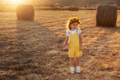 Happy girl child in yellow dress runs in autumn field - PhotoDune Item for Sale