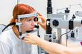 Teenage girl with red hair gets laser eye coagulation - PhotoDune Item for Sale