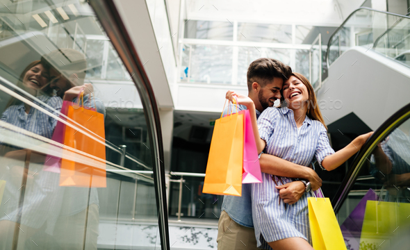 Happy attractive loving couple enjoy shopping together - Stock Photo - Images