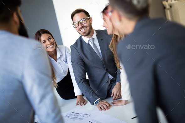 Team of architects working on construction plans - Stock Photo - Images