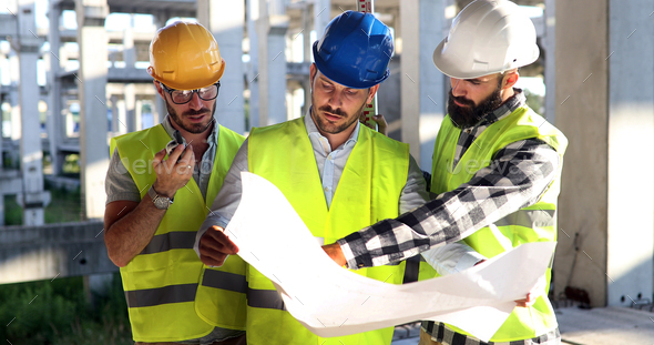 Construction engineers discussion with architects at construction site - Stock Photo - Images