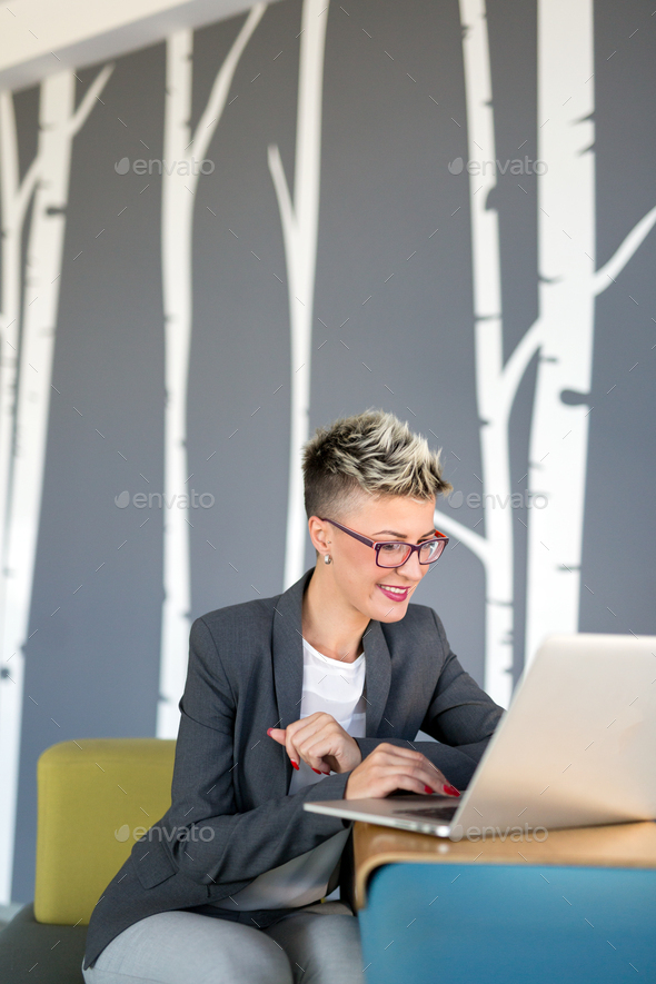 Portrait of businesswoman working on computer in office - Stock Photo - Images