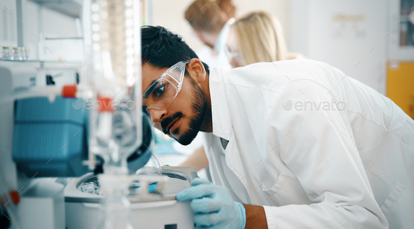 Young students of chemistry working in laboratory - Stock Photo - Images