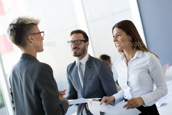 Picture of business colleagues talking in office - Stock Photo - Images