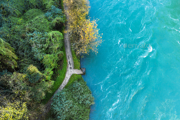 Aerial view of a river with small pier - Stock Photo - Images