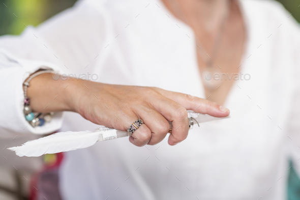 Guardian Angel Virtue, Hand of a Spiritual Healer Holding a Crystal with White Feather - Stock Photo - Images