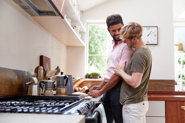 Male Gay Couple At Home In Kitchen Making Breakfast Together - Stock Photo - Images