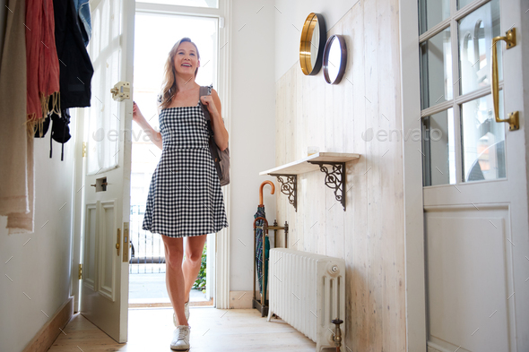 Woman Wearing Backpack Opening Front Door Coming Home From Work - Stock Photo - Images
