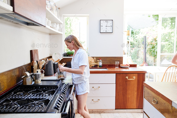 Woman Wearing Pajamas At Home In Kitchen Making Fresh Coffee - Stock Photo - Images