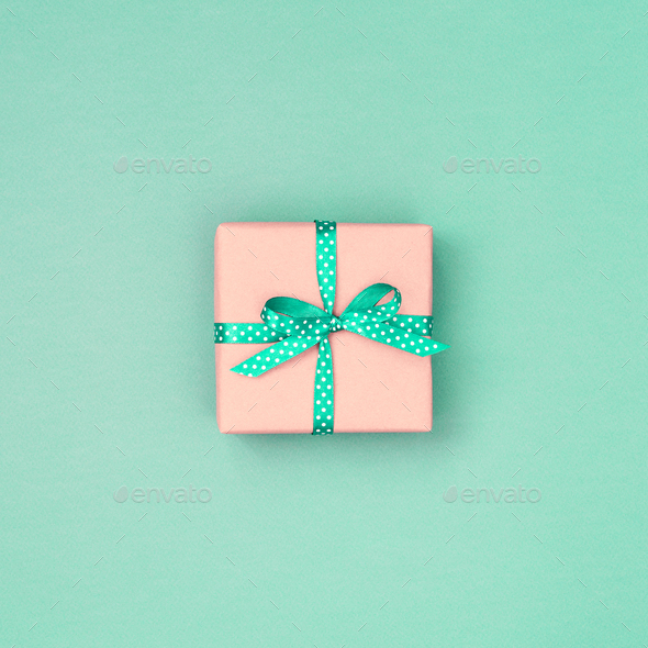 Gift Box with Bow on Mint Background. - Stock Photo - Images