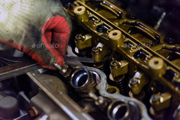 Maintenance check and adjust valve lash in car engine - Stock Photo - Images