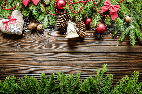Flat lay Christmas border background of twigs, baubles and handm - Stock Photo - Images