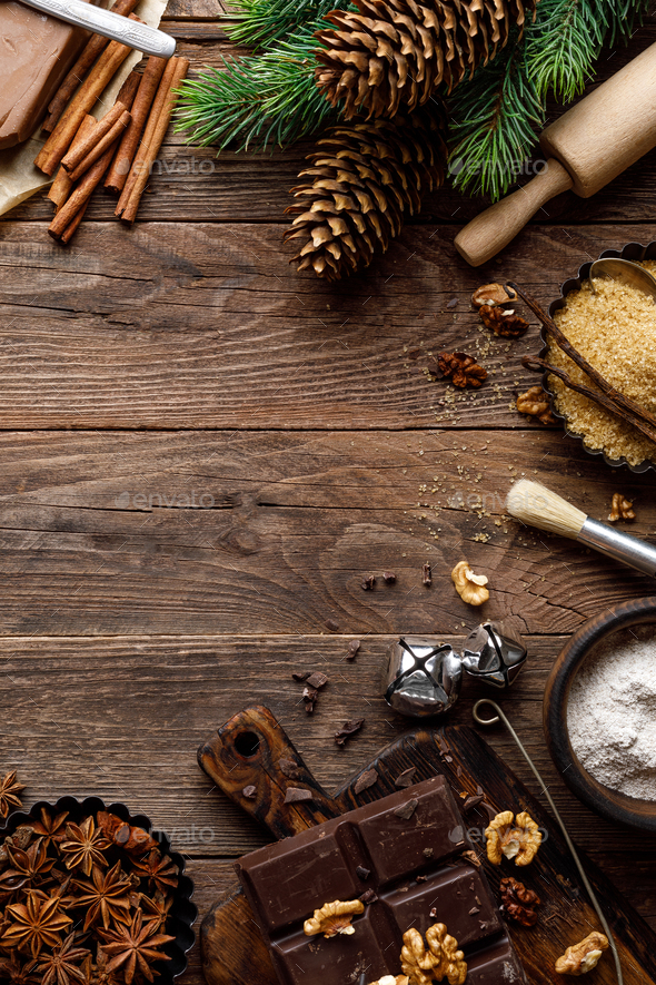 Christmas or new year culinary rustic wooden background with food ingredients for cooking - Stock Photo - Images