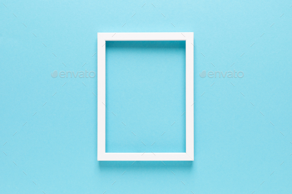 Empty photo frame on blue background with copy space, top view - Stock Photo - Images
