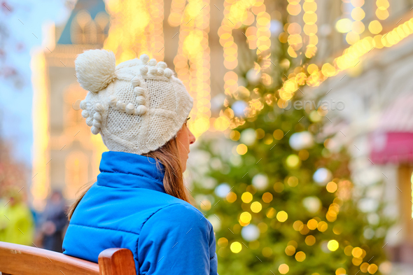 Woman looking at Christmas tree - Stock Photo - Images