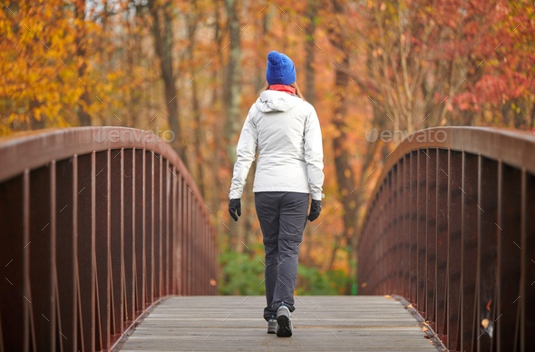 Woman hiking at autumn day - Stock Photo - Images