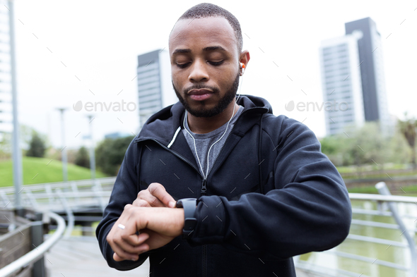 Fit and sporty young man preparing for a run in the city. - Stock Photo - Images