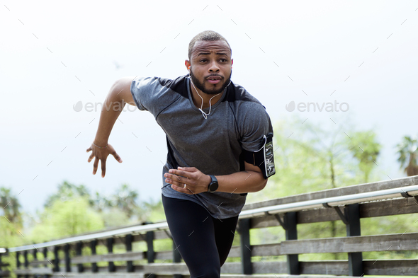 Fit and sporty young man running in the city. - Stock Photo - Images