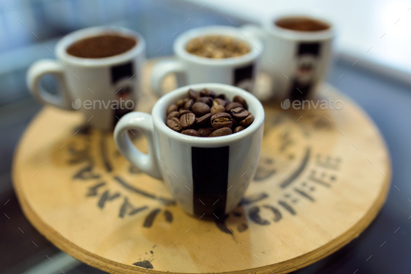 Close-up of four types of coffee beans in cups in an organic sto - Stock Photo - Images