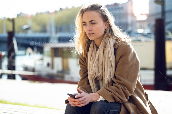 Sad young woman thinking about her problems while sitting next t - Stock Photo - Images