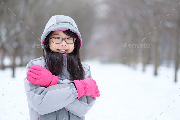 Portrait of Asian teen in winter - Stock Photo - Images