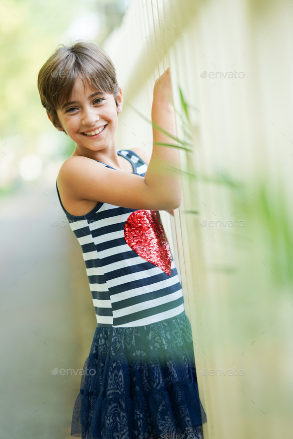 Little girl, eight years old, having fun outdoors - Stock Photo - Images