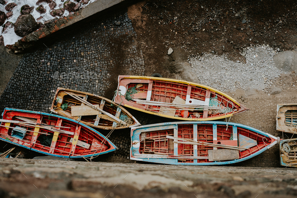 Local traditional fishing boats under shalter during storm in atlantic ocean. View from above, view - Stock Photo - Images