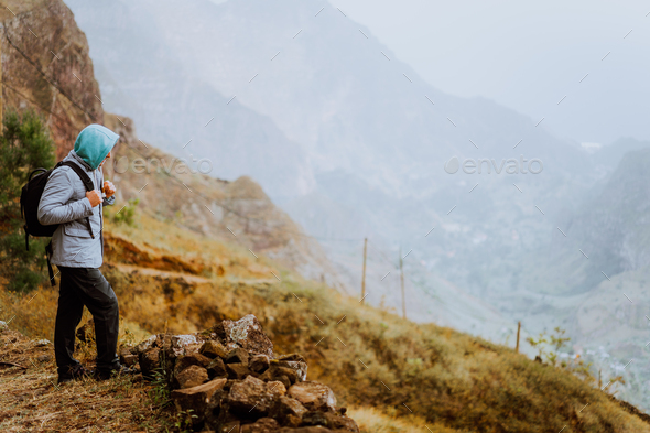 Male hiker looking down to Xo-Xo Valley. Santo Antao Island, Cape Verde. Traveler on mountains cliff - Stock Photo - Images