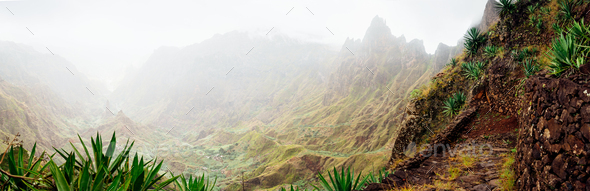 Panorama of Xo-Xo valley surrounded by harsh mountain peaks. Steep walk path covered by yucca plants - Stock Photo - Images