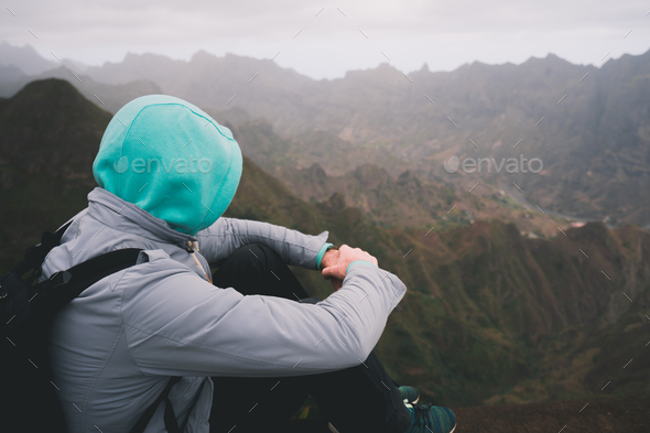 Traveler enjoying magnificent remote moment above huge mountain ranges on Santo Antao island, Cape - Stock Photo - Images